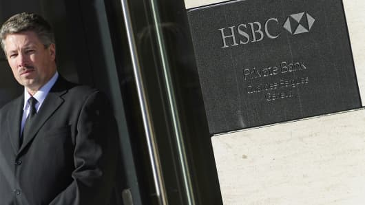 A security guard stands in front of the HSBC offices in Geneva, Feb. 9, 2015.