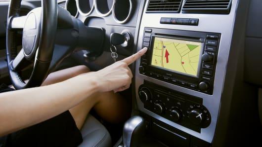 Woman using car GPS