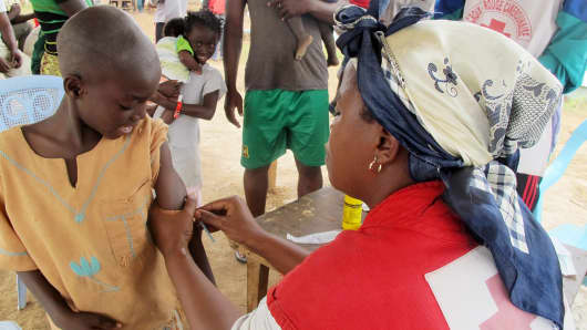 A child from the Central African Republic receives a measles vaccination at a refugee camp set up by the UNHCR in Nangungue, eastern Cameroon on April 12, 2013