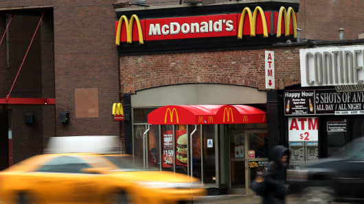 Cars move past a McDonald's in lower Manhattan on February 9, 2015 in New York City.