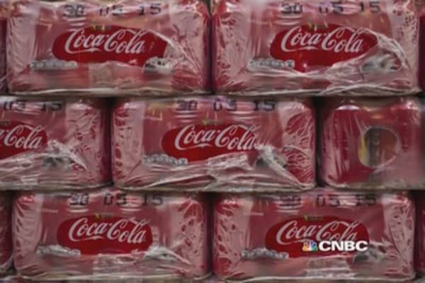 Coke KO's Q4 earnings, beats estimates