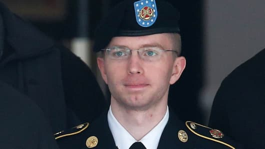 US Army Private First Class Bradley Manning is escorted out of a military court facility during the sentencing phase of his trial August 20, 2013 in Fort Meade, Maryland.