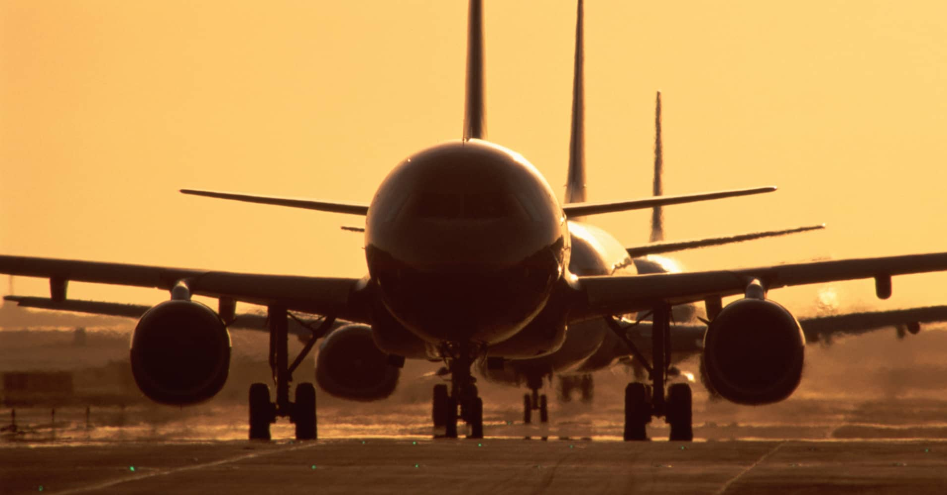Airplanes wait at airport