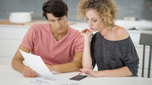 Couple bills financial stress