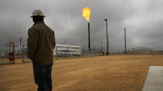 Flared natural gas is burned off at Apache Corporation's operation at the Deadwood natural gas plant in the Permian Basin in Garden City, Texas.