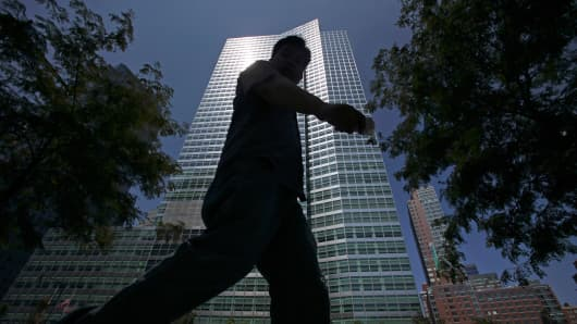 Pedestrians walk in front of Goldman Sachs Group's headquarters in New York.