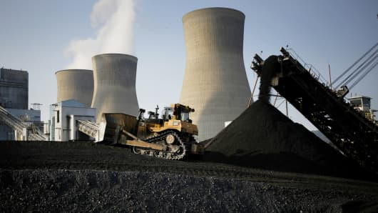 A bulldozer moves coal that will be burned to generate electricity at the American Electric Power coal-fired power plant in Winfield, West Virginia.