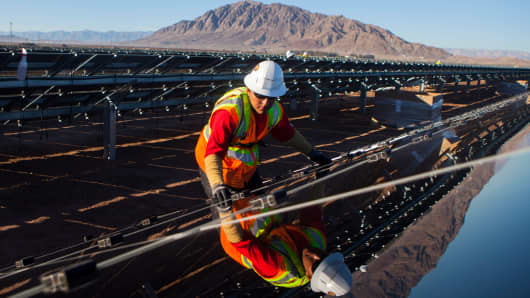 A contractor for First Solar works on construction of a solar project in Imperial County, California.