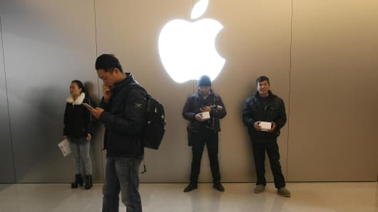 People in an Apple Store in Chongqing, China.
