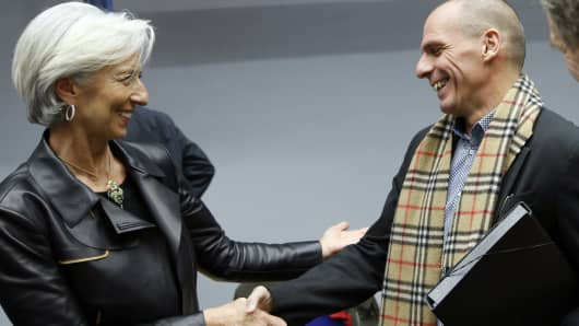 International Monetary Fund (IMF) Managing Director Christine Lagarde (L) listens to Greek Finance Minister Yanis Varoufakis during an extraordinary euro zone finance ministers meeting to discuss Athens' plans to reverse austerity measures agreed as part of its bailout, in Brussels February 11, 2015.