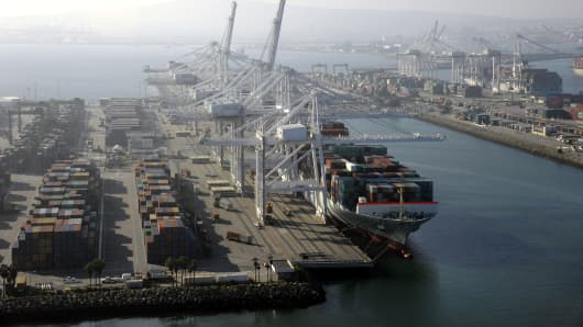 A container ship is docked at the ports of Los Angeles and Long Beach, Calif., in this aerial photo taken Feb. 6, 2015.