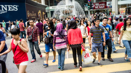 Shoppers at the Pavilion Mall shopping center in downtown Kuala Lumpur, Malaysia.