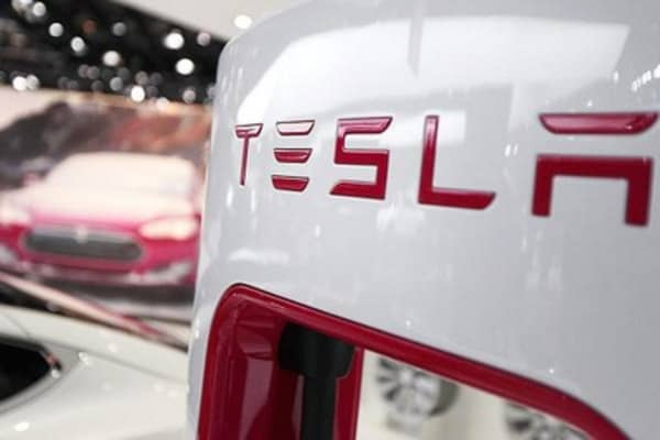 Tesla earnings stop short of estimates