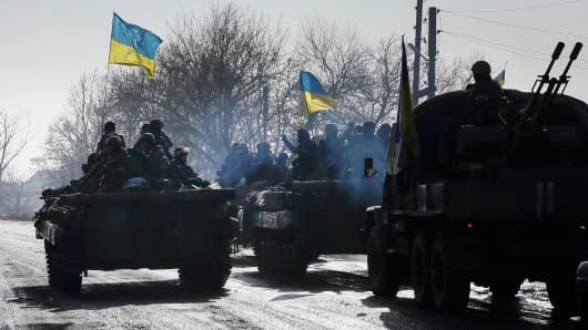 Members of the Ukrainian armed forces ride on an armored personnel carrier near Debaltseve, Ukraine, February 12, 2015.