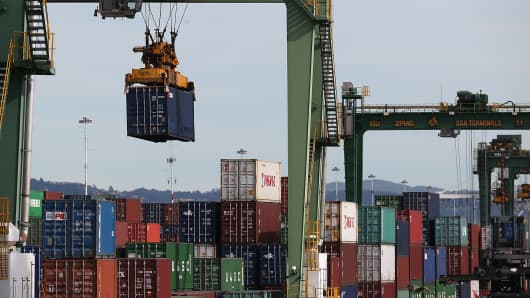 A shipping container is moved at the Port of Oakland.