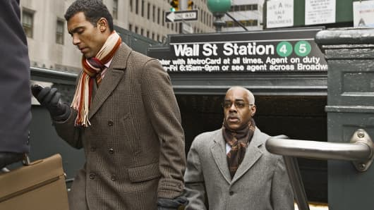 Businessmen exiting Wall Street subway station