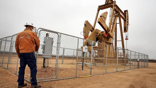 Oil worker near pump jack