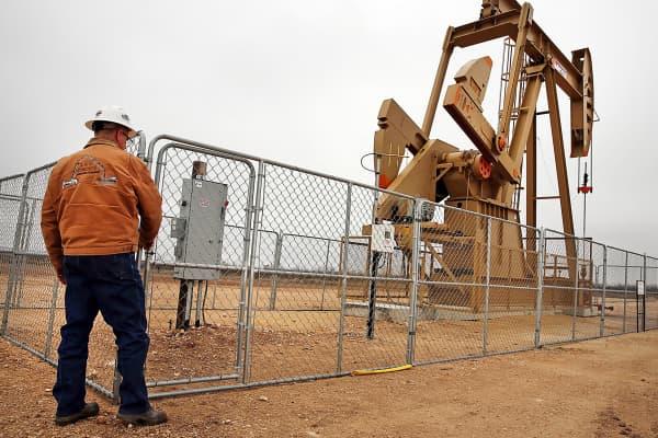 Oil worker near pump jack