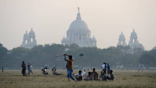 Locals play cricket in Kolkata, India.