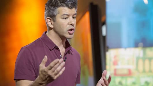 Uber co-founder and CEO Travis Kalanick gestures as he speaks during an interview in Hong Kong.