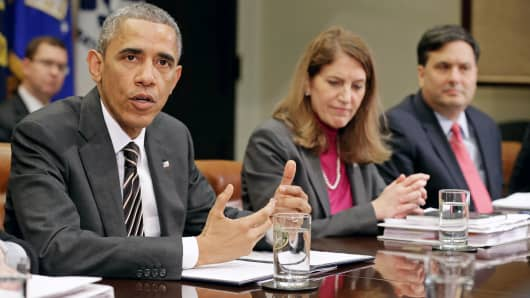 President Barack Obama speaks to reporters before meeting with Health and Human Services Secretary Sylvia Matthews Burwell, Ebola response coordinator Ron Klain and other members of the president's national security and public health teams at the White House on Dec. 12, 2014.
