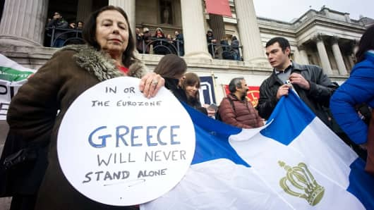 Protesters gather at Trafalgar Square to support the newly elected government officials in Greece to negotiate a better deal with the European Union with regards to the Greek national debt crisis.