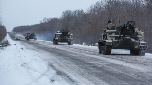 Ukrainian soldiers drive in the direction of the embattled town of Debaltseve on February 16, 2015 in Artemivsk, Ukraine.
