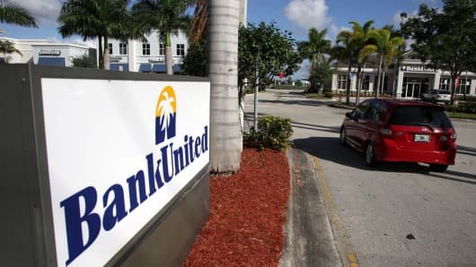 A car enters a BankUnited branch in Fort Lauderdale, Florida.