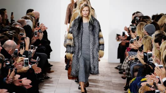 Models walk the runway at the Michael Kors Fall 2015 fashion show during New York Fashion Week, Feb. 18, 2015.