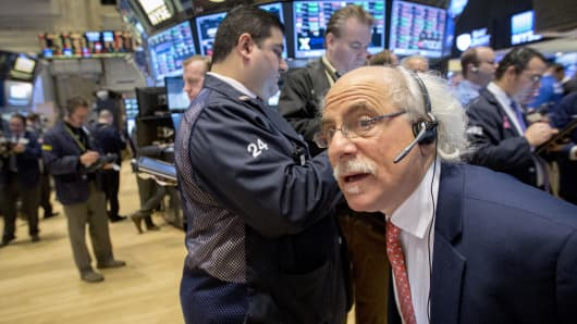 Traders work on the floor of the New York Stock Exchange Feb. 18, 2015.
