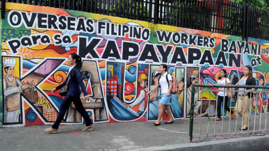 A mural honoring overseas Filipino workers in Manila.