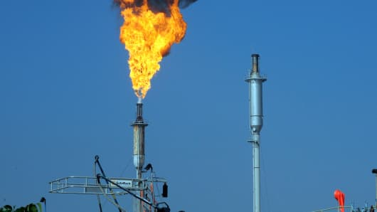 Flames leap from a burner unit at the Exxon-Mobil refinery in Torrance, Calif.