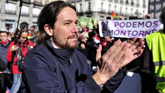 Pablo Iglesias, leader of the Spanish Podemos (We Can) left-wing party, applauds before giving a speech to his supporters in Madrid, Spain, Jan. 31, 2015.