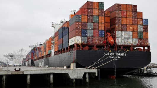 A container ship docked at the Port of Oakland, in Oakland, Calif.