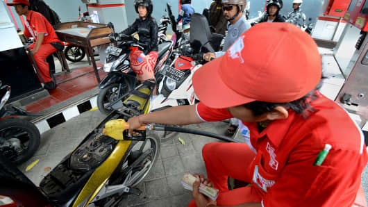 Motorists line up at a gas station in Bali, Indonesia.