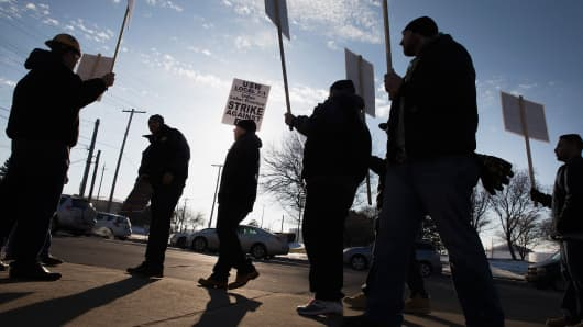 Members of the United Steelworkers Union and other supporting unions picket outside the BP refinery on February 10, 2015 in Whiting, Indiana.
