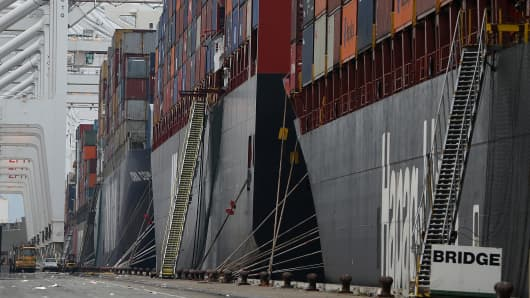 Container ships sit docked in a berth at the Port of Oakland on February 17, 2015 in Oakland, California.