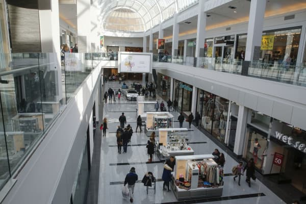 People are seen walking through Roosevelt Field shopping mall in Garden City, N.Y.