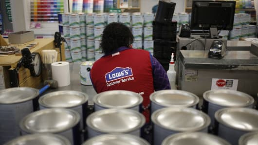 An employee works in the paint department at a Lowe's Cos. store in Louisville, Kentucky.