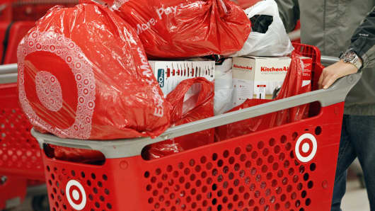 A customer pushes a shopping cart laden with merchandise at a Target Corp. store opening ahead of Black Friday in Chicago, Illinois.