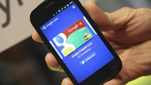 The Google Inc. Mobile Wallet application for cardless payment is displayed on a smartphone screen.