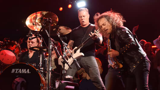 Musicians Lars Ulrich, James Hetfield and Kirk Hammett of Metallica perform.