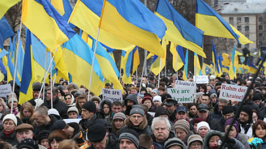 People carrying Ukrainian flags participate in the 'March of Dignity' in Kiev, Ukraine.