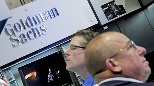 Traders work at the Goldman Sachs booth on the floor of the New York Stock Exchange.