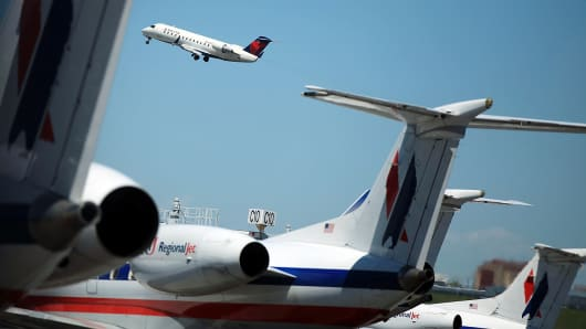 A plane takes off at LaGuardia Airport in New York.