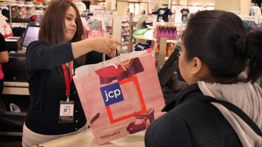A shopper makes a purchase at JC Penney in North Riverside, Illinois.
