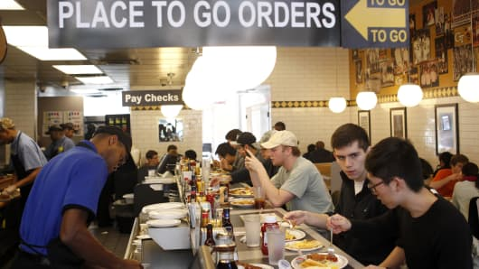 Customers dine at the Waffle House which just partnered with delivery service Roadie.