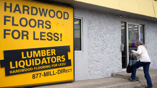 A customer enters the Lumber Liquidators store in Denver.