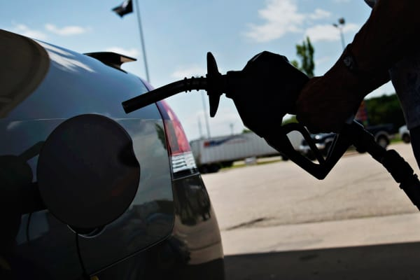 A customer prepares to fuel her vehicle at a Road Ranger gas station in Princeton, Ill.