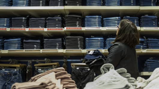 A customer browses jeans at a Gap Inc. store in San Francisco.